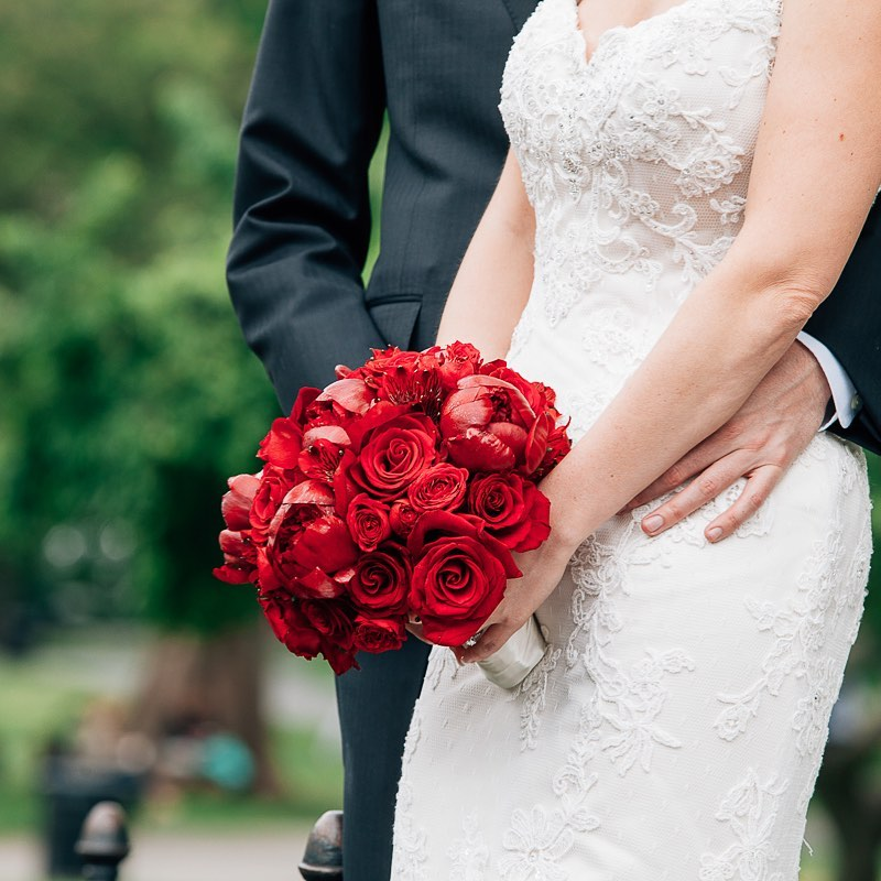 Photograph of bride and groom and floral bouquet